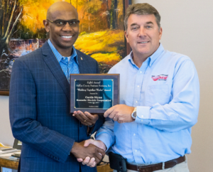 Pictured left to right: Curtis Wynn, Chief Executive Officer of Roanoke Electric Cooperative and Scott Aman, Treasurer of Halifax County Business Horizons.